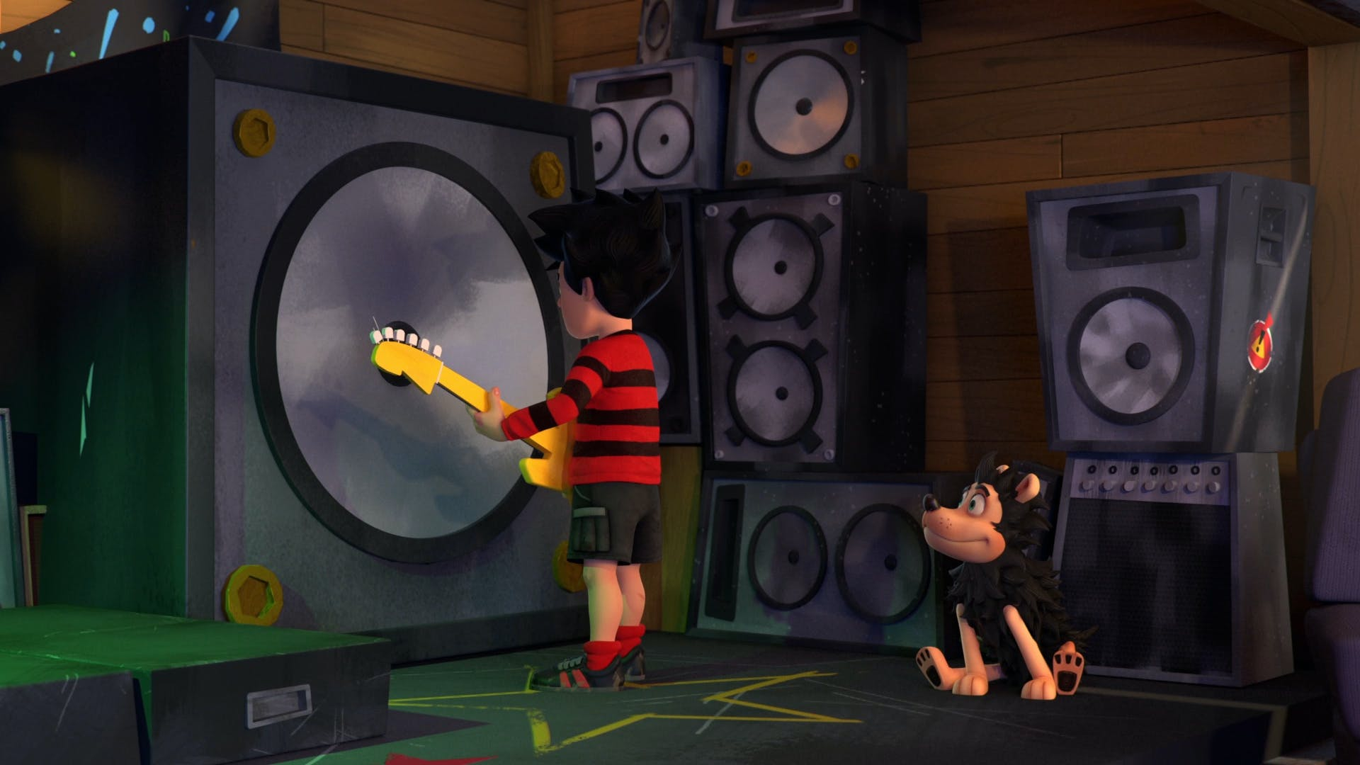 Dennis and Gnasher in front of the speakers