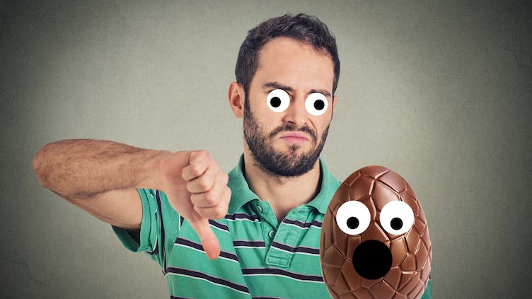 A man saying no to eating Easter eggs