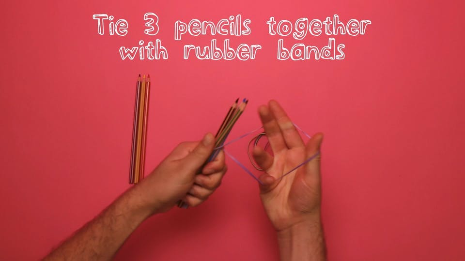 Take three pencils and wrap them together using rubber bands