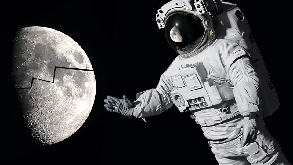 An astronaut looking at the moon