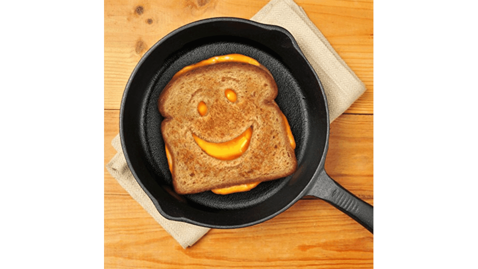 Smiling grilled cheese toastie