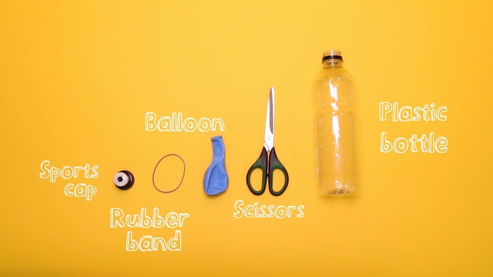 You will need - bottle, scissors, balloon, rubber band, sports cap