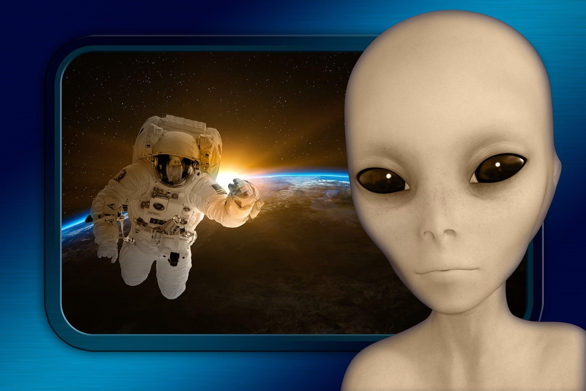 An astronaut approaching an alien spacecraft