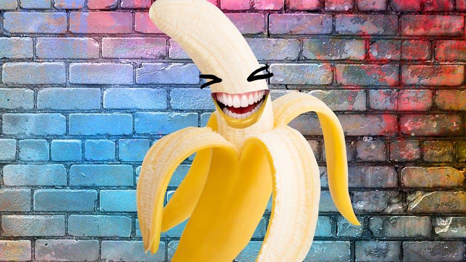 banana laughing on brick background