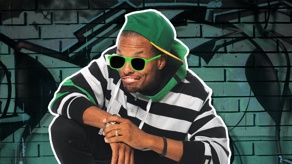 A man in a hoodie, cap and green sunglasses