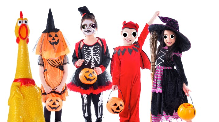 Children in Halloween costumes on white background