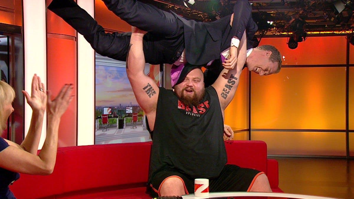 Strongman Eddie Hall lifting BBC Breakfast's Dan Walker above his head