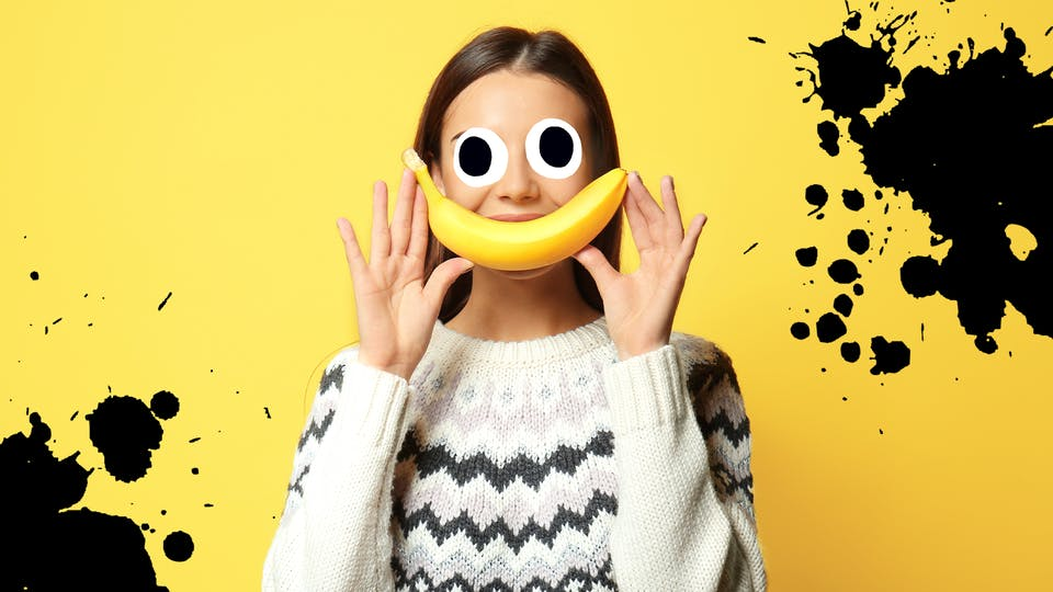 Woman with banana on yellow background