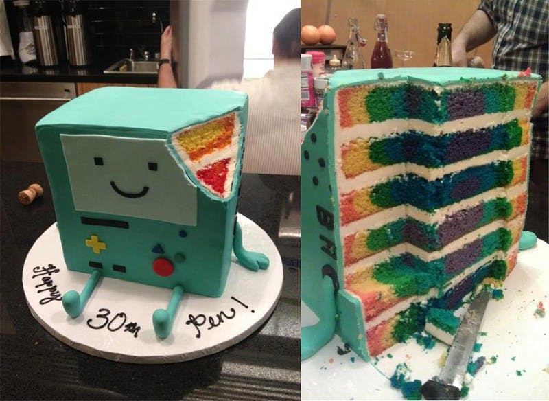 Adventure Time's Beemo as a rainbow cake