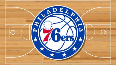 A Philadelphia 76ers badge