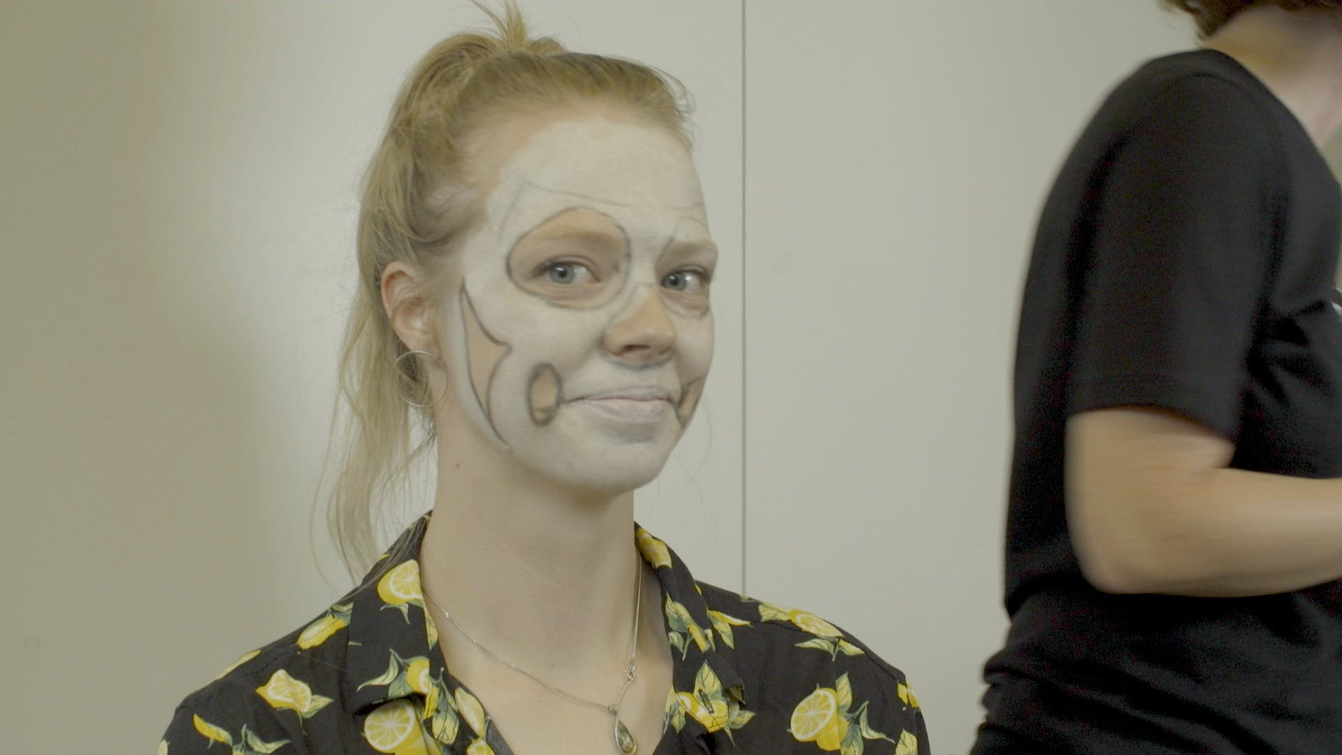 Emma with a bunch of paint on her face