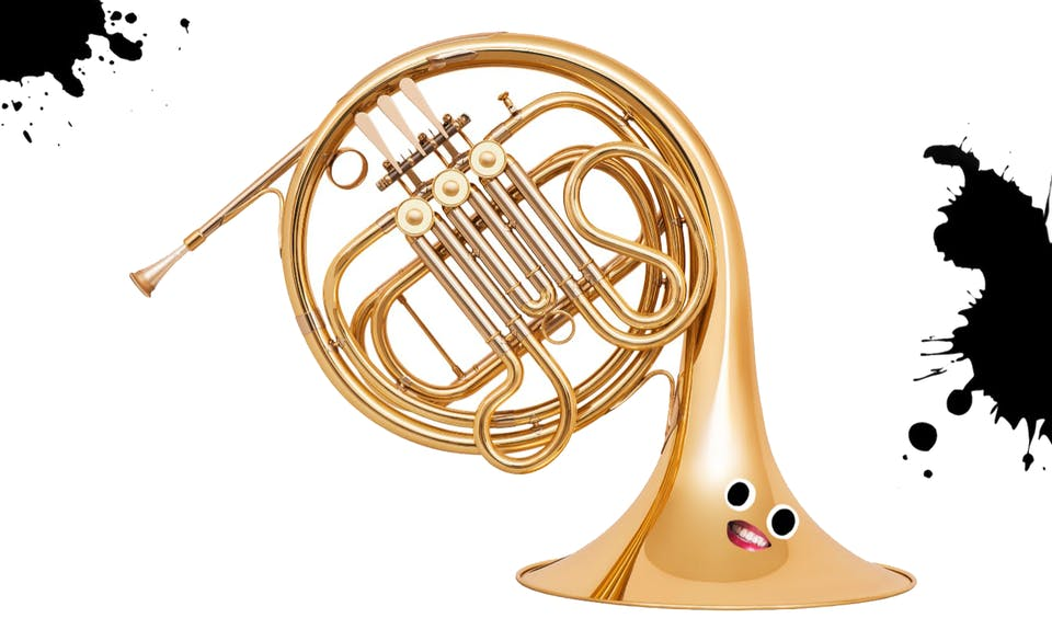 French horn with a cartoon face