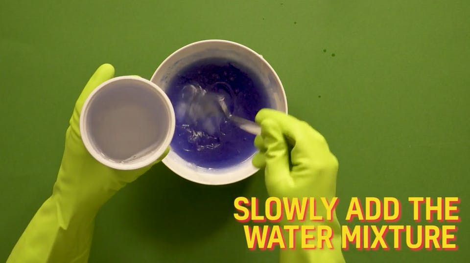 Slowly add the mixture of baking soda and water into your bowl and stir