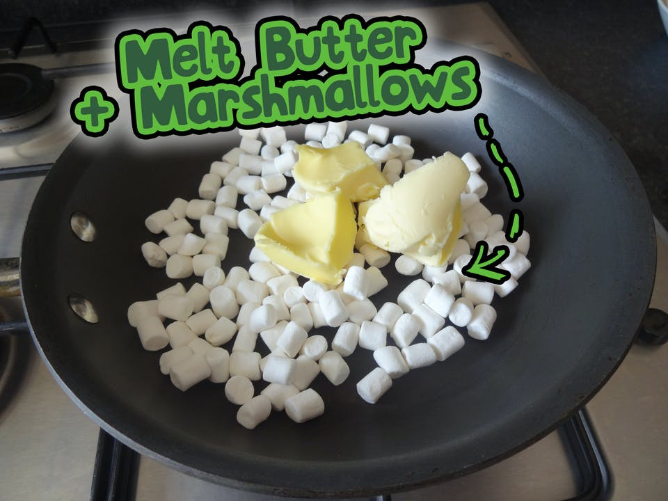 Melt marshmallows and butter in a frying pan.