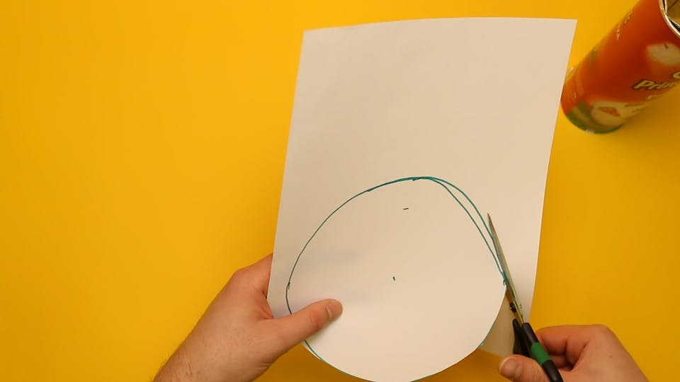 Draw a circle on a sheet of paper and then cut it out