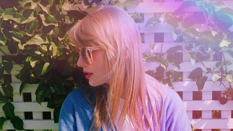 Taylor Swift and a rainbow