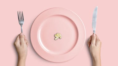 A tiny piece of cauliflower on a pink plate