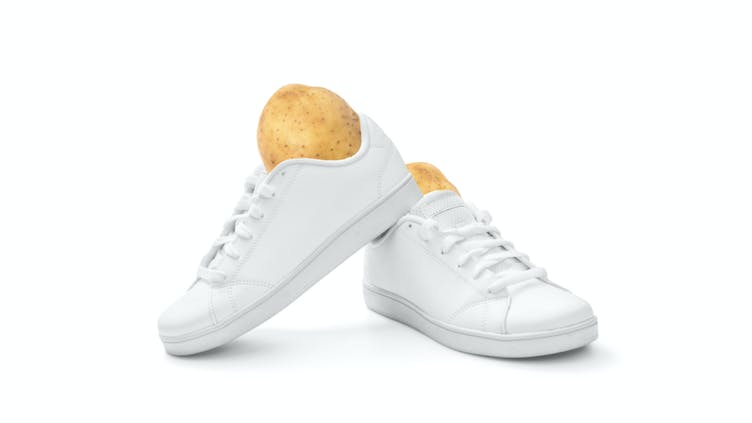 Baking potatoes in a white pair of trainers