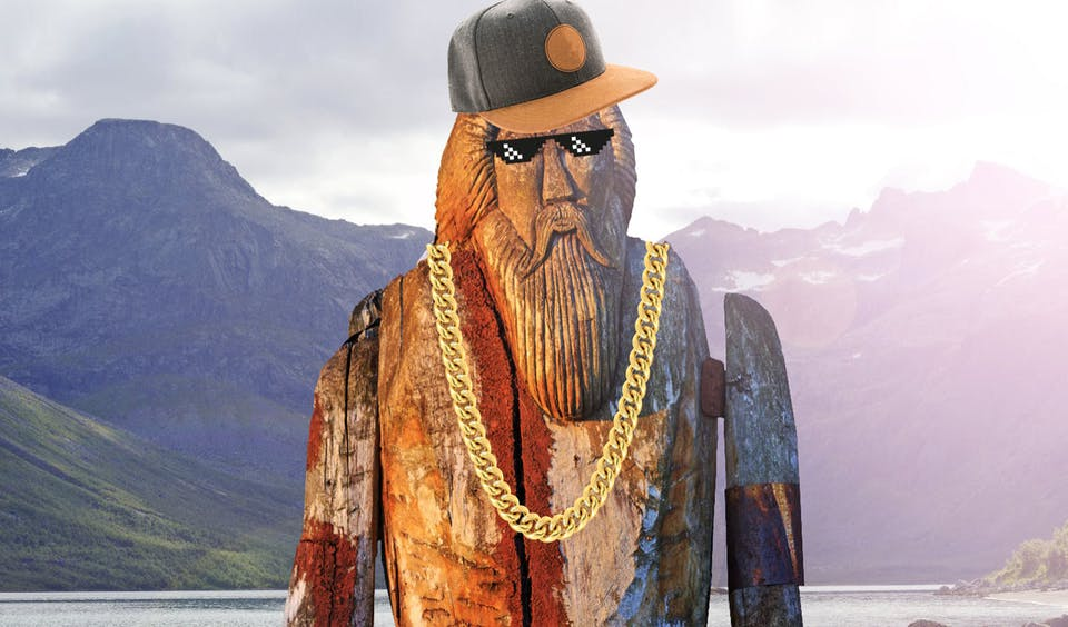 Wooden statue of Odin with baseball cap, gold chain and sunglasses
