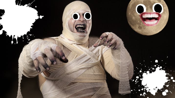 Man dressed as mummy on black background