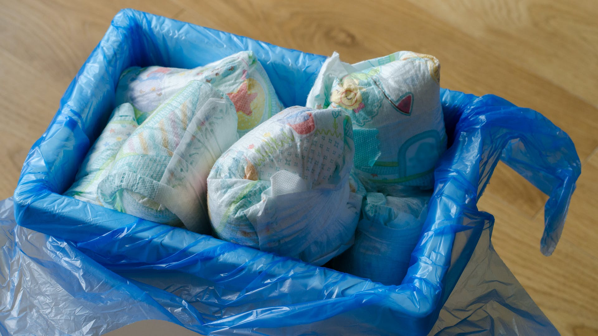 A bin full of dirty nappies