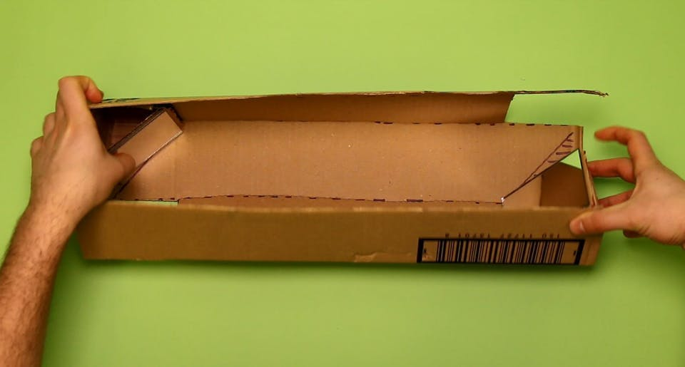 Fold up your cardboard to make a square tube