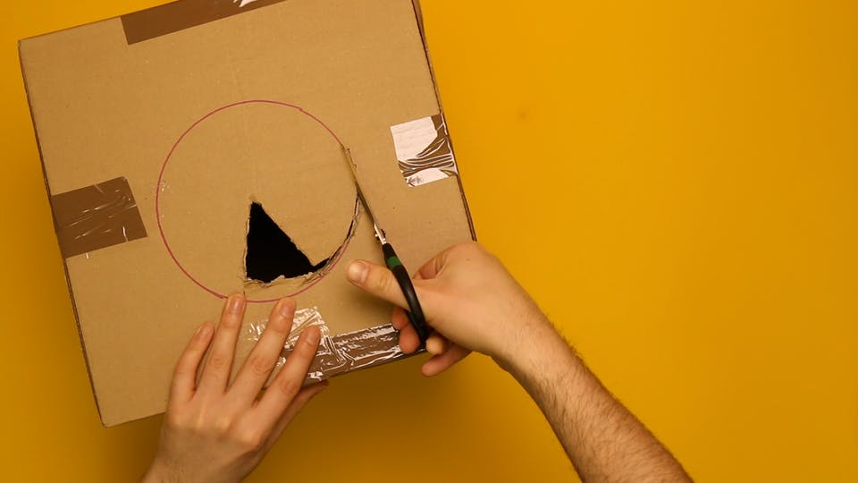 Draw a circle on the box and cut it out