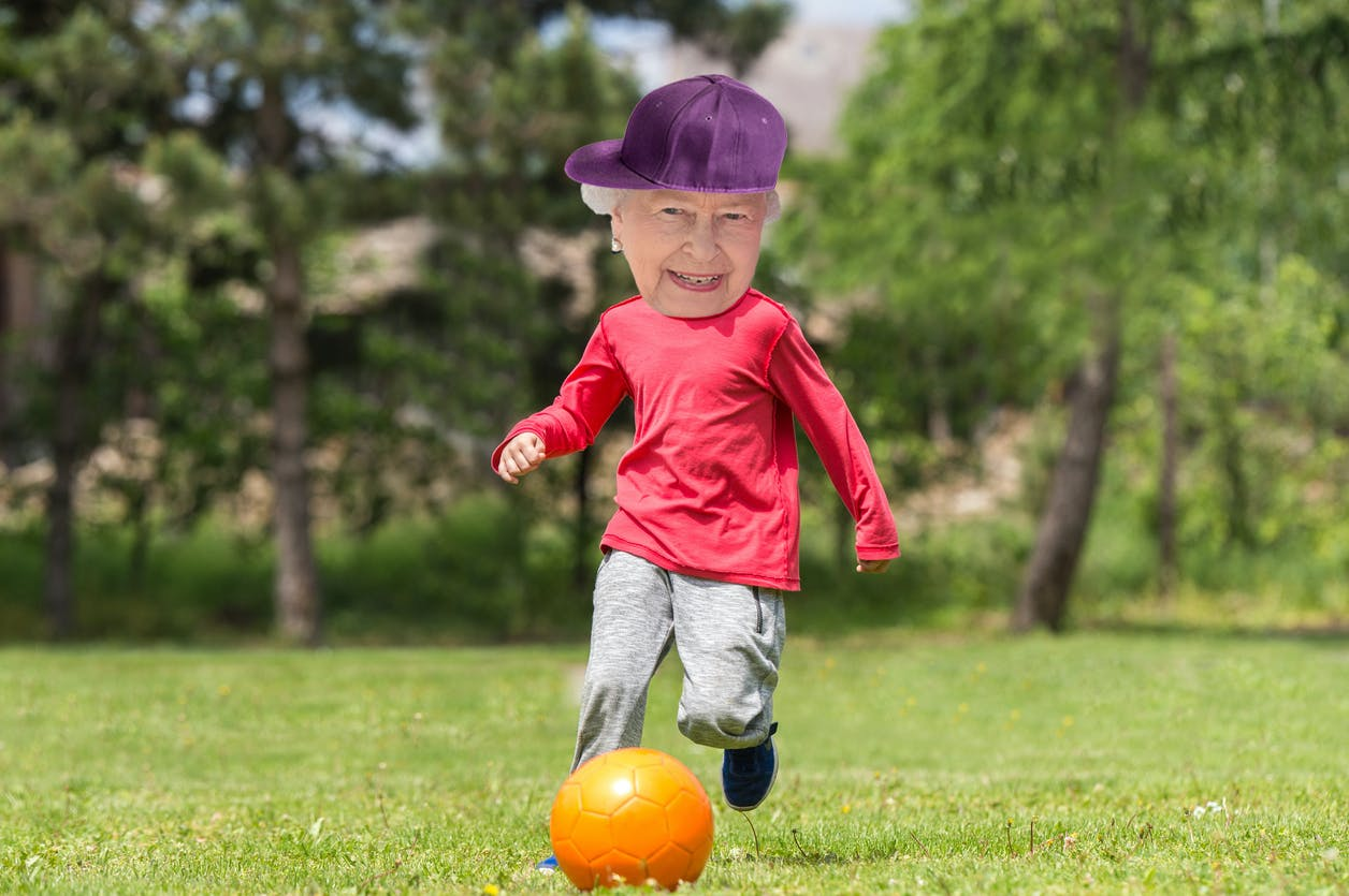 The Queen as a kid playing football and wearing a hat