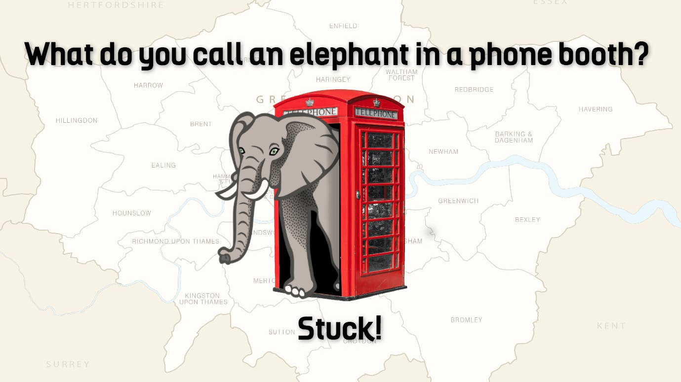 This is an image on an elephant stuck in a phone booth