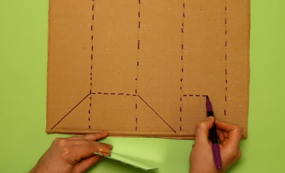 Using your mirror as a measurement, draw a triangle, square, and triangle along the bottom of the cardboard. Draw a second square in the final right lane.