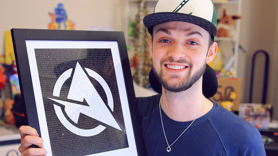 Ali-A with his award for passing 11 million subscribers in 2018