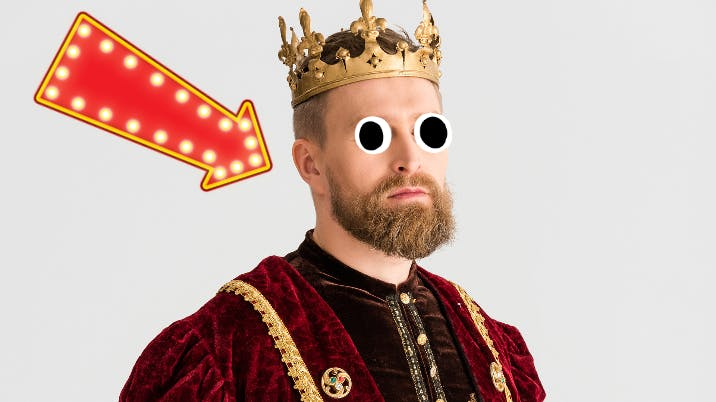 Man dressed as king on white background