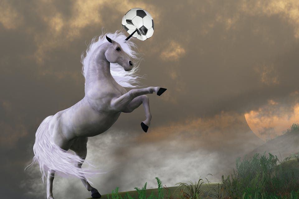 A unicorn bursting a perfectly good football