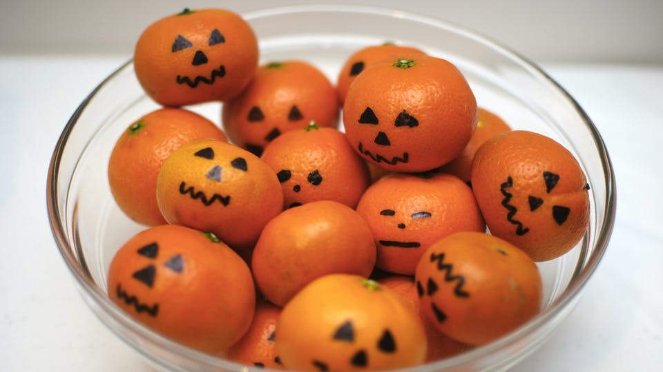 A bowl of satsumas disguised as tiny pumpkins