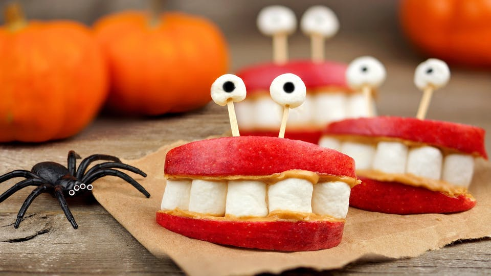Fake teeth made out of apple and marshmallow