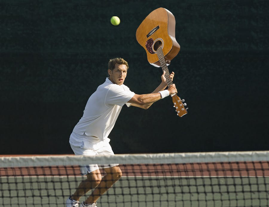 Dude playing tennis with a guitar