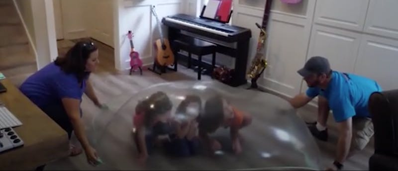 Three kids hide in a massive slime bubble